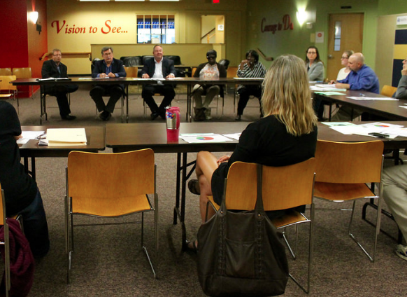 Residents attend a TNT meeting held last year with a guest from CENTRO at the South Side Innovation Center. | File Photo