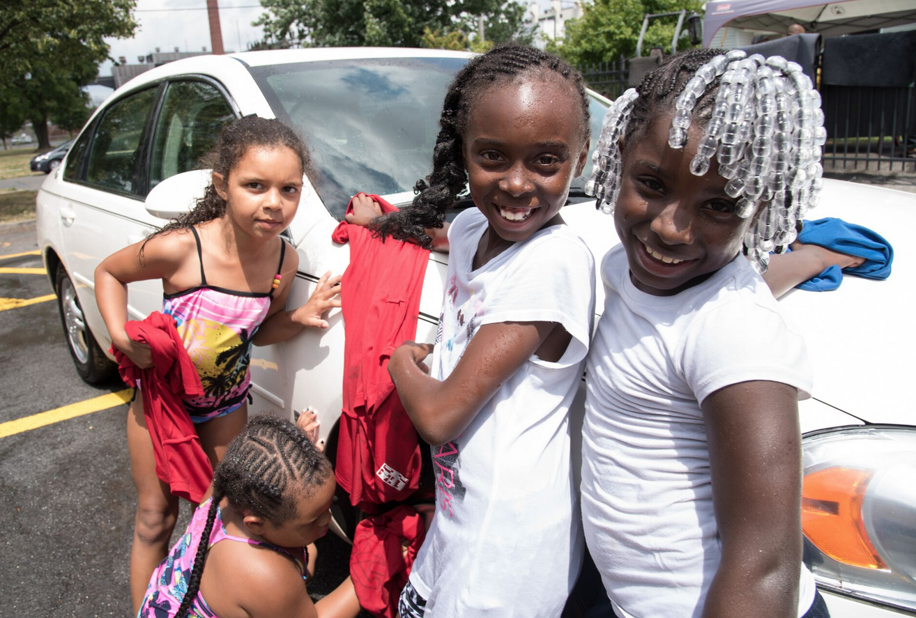 Youth at the Central Village Boys & Girls Club hold a car wash fundraiser from noon to 3 p.m. every Friday outside the center located at 212 Van Buren St. | Marianne Barthelemy