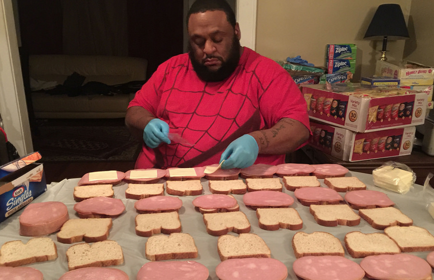 Alamin Muhammad prepares sandwiches before distributing to homeless in Syracuse.