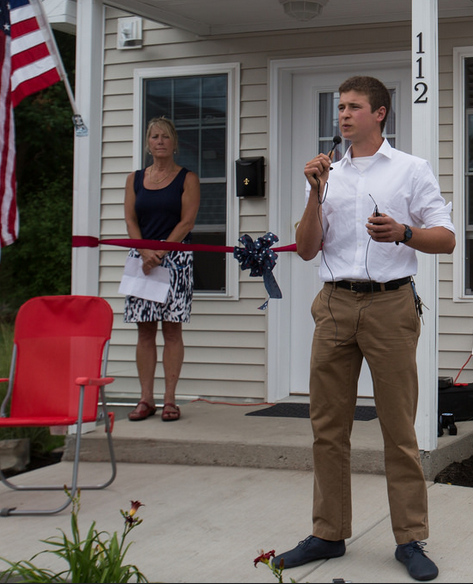 Andrew Lunetta thanks the crowd for all the support he received during the process of building the first tiny home unit through the nonprofit A Tiny Home for Good he runs. A ribbon-cutting ceremony held July 22 opened the doors for two Syracuse veterans who have faced homelessness.