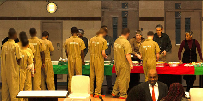 Volunteers Serve Holiday Meal to Incarcerated Youth