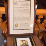 A photo of William Herbert Johnson with a framed certificate admitting him to the New York State Bar Association. | Brenda Muhammad, Staff Photographer